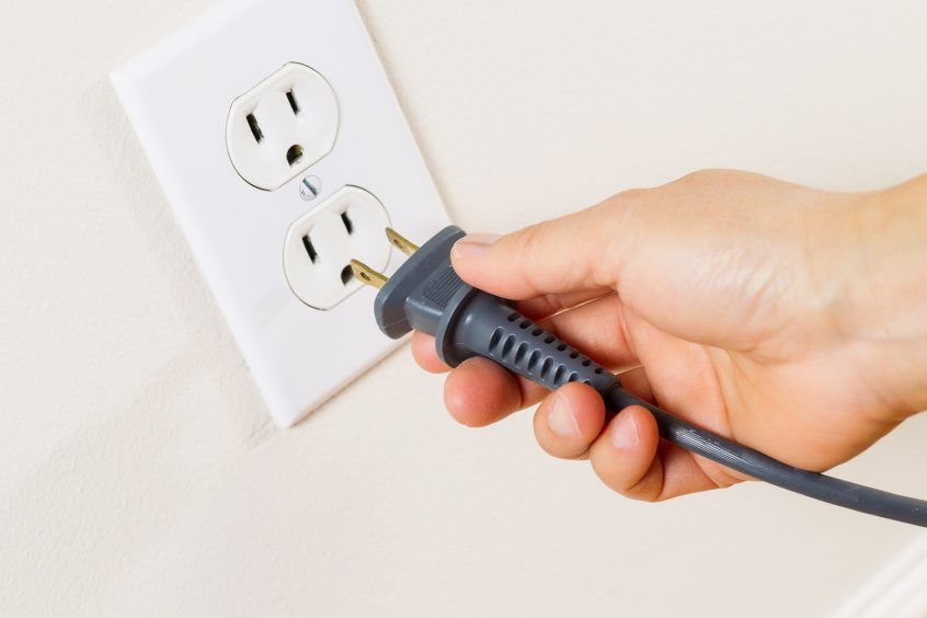 Inserting a plug into an outlet