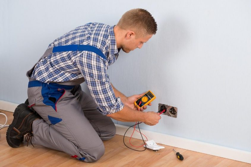 Electrician doing electrical maintenance